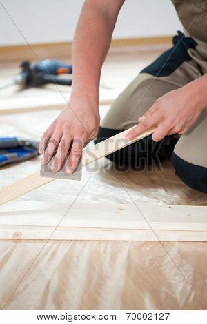Man Renovating Floor In New Flat