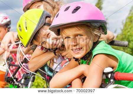 Close up view of blond girl and boy in helmet