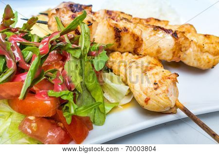 tasty beef steak kabobs with vegetables on plate
