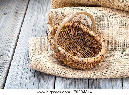 Empty Wicker Basket On The Wooden Background