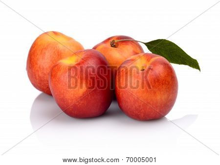 Three Nectarines With Leaf Isolated On White