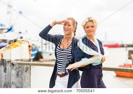 Woman enjoying vacation at German north sea ship pier visiting the Harbor
