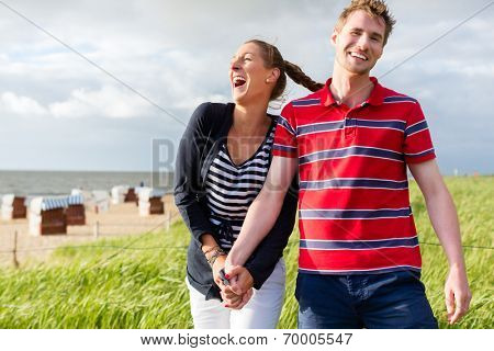 Couple enjoying vacation in German north sea beach dune