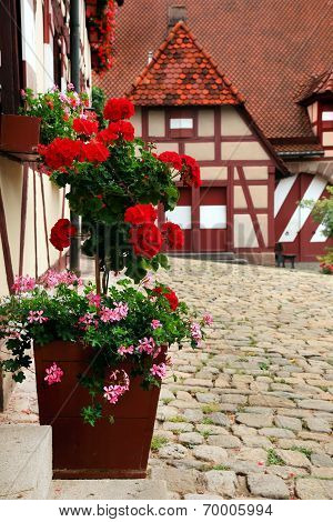 Courtyard Decoration With Flowers. Kaiserburg, A Part Of Emperor's Castle, Nuremberg, Germany