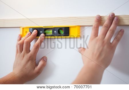 Man's Hands With The Level