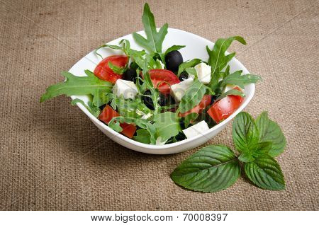Greek Salad In White Salad Bowl On Sacking