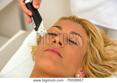 Therapist applying lipo massage LPG treatment - selective focus narrow DOF