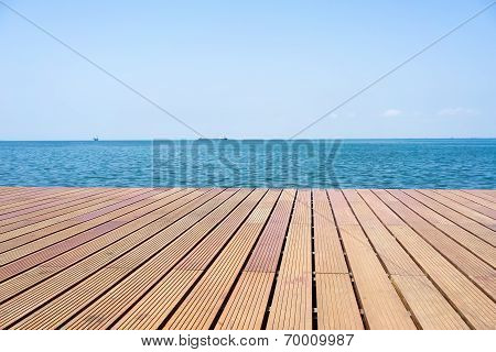 Wooden Platform Beside Sea With Clear Sky