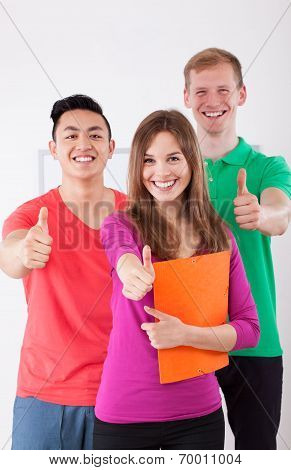Happy Students Showing Thumbs Up Sign