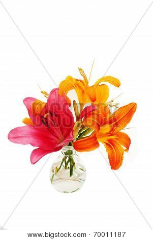 Red And Orange Lilies Bouquet In A Glass Vase