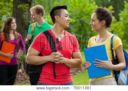 Multi-ethnic Students With Folders And Backpacks