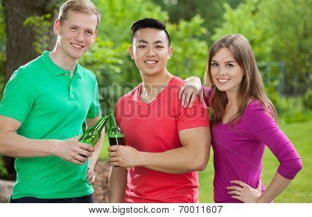 Friends Drinking Beer In Park