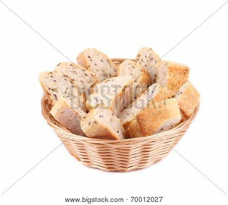 Wicker basket with bread slices.