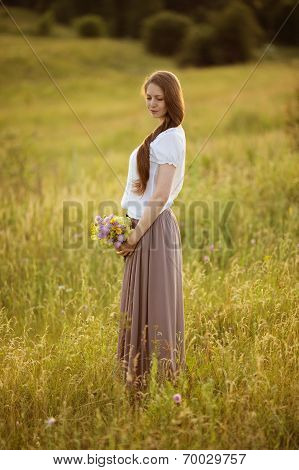 Lonely Woman With Bouquet Of Flowers