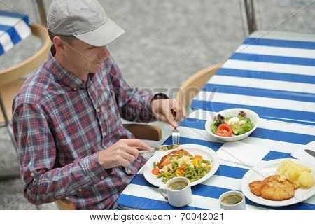 Man eating his lunch in a restaurant