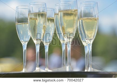 Glass of champagne on a tray during a party
