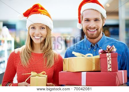 Happy couple with purchases for Christmas