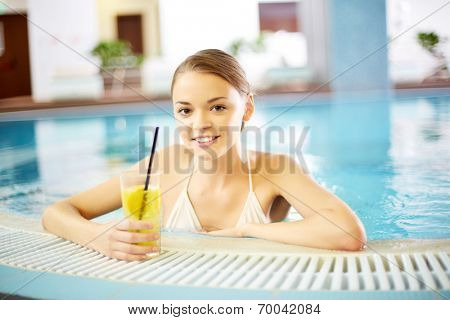 Young girl relaxing in swimming pool