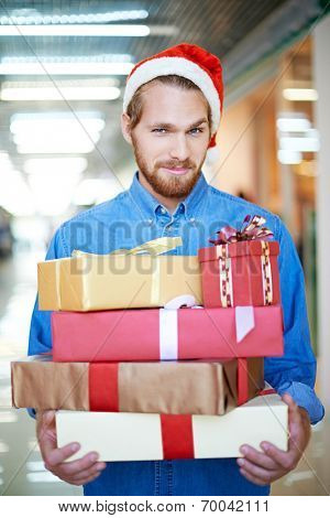 Man holding heap of gift boxes