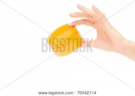 Female hand holding a cream