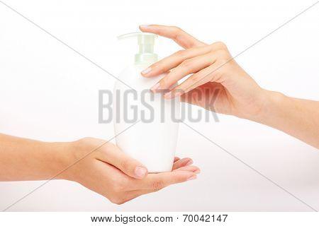 Female hands presenting liquid soap