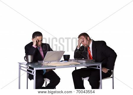 Stressed Businessmen Working Together To Meet The Deadline