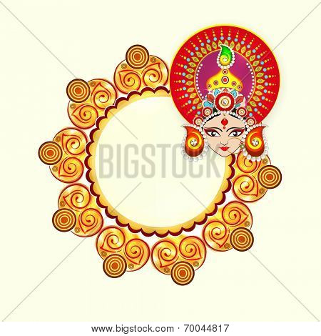 Beautiful face of Goddess Durga wearing crown decorated with colorful pearls and space for your message on Dussehra festival