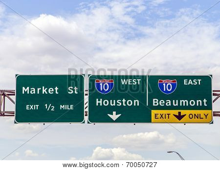 Street Signs At The Interstate In Texas