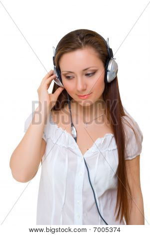 Girl In Headphones Listens To Music, Looking Down