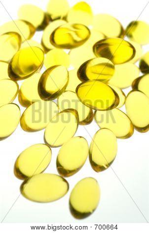 Close Up Of Yellow Gel Capsules.
