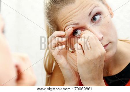 Woman Take Out Contact Lens Of Her Eye