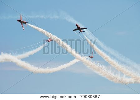 EASTBOURNE, ENGLAND - AUGUST 15, 2013: RAF aerobatic team The Red Arrows perform at the annual free Airbourne airshow at Eastbourne in East Sussex. The team were formed in 1965.