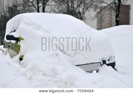 Car Covered Snow During Winter