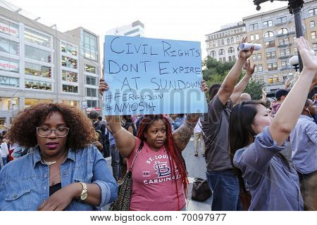 Raised arms & protest signs