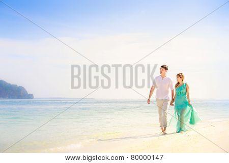 Young Happy Asian Couple On Honeymoon