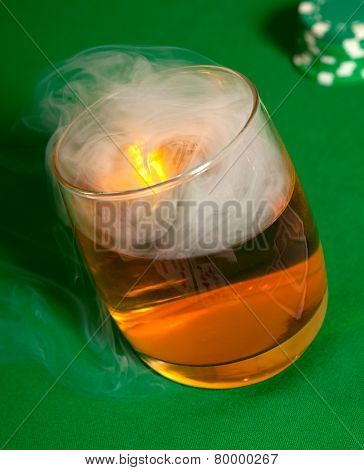 Smoke in a glass with a drink.