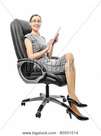 Business Woman Sitting On Chair Working With A Tablet.