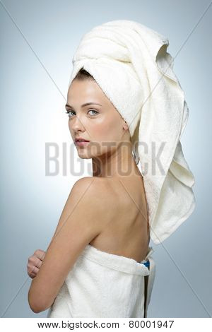 Portrait of attractive woman with clean face after bath