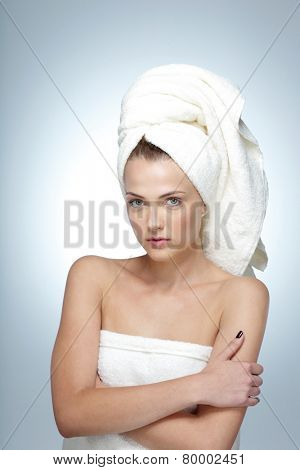 Portrait of cute young woman with fresh skin and towel on head