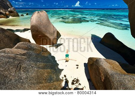 Woman at beautiful beach at Seychelles