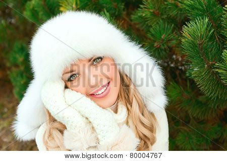 Girl in winter forest