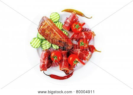 fresh served roasted meat chunk and rolls on white platter