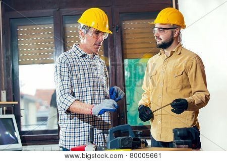 Craftsmen in the workshop working together, selective focus