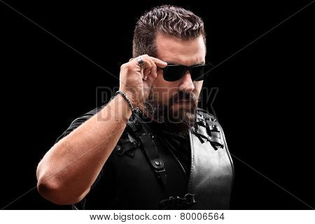 Biker with sunglasses looking at the camera on black background