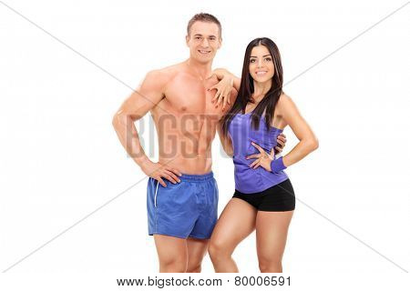 An athletic young couple posing together isolated on white background