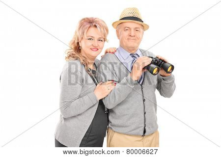 Mature couple posing with binoculars isolated on white background