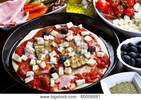 Pizza With Ham,pepper,zucchini And Black Olives Ingredients