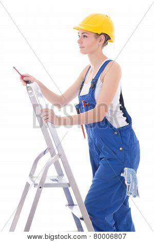Young Woman Electrician In Workwear With Screwdriver On Ladder Isolated On White