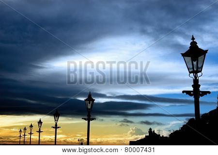 Row Of Vintage Lamps And Lighthouse