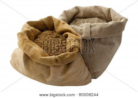 henna powder closeup isolated white red black linen bags